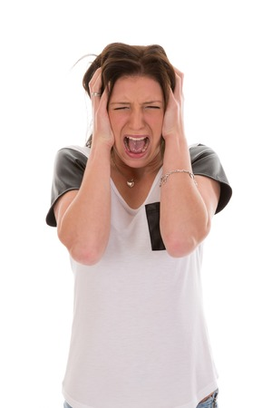 Anxious young woman yelling of fear photo