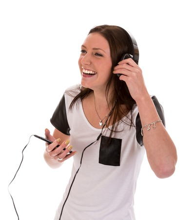 Happy woman with headphones listening to music of her telephone photo