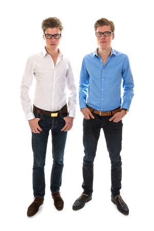 Male twins with white and blue blouse standing together photo