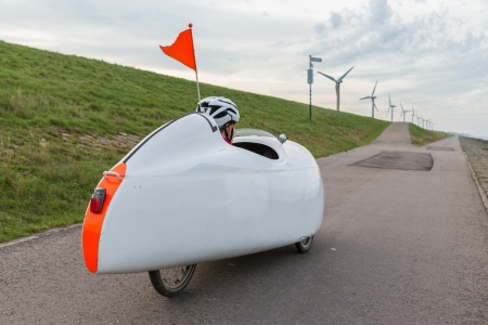Velomobile bicycle along Dutch coast Stockfoto