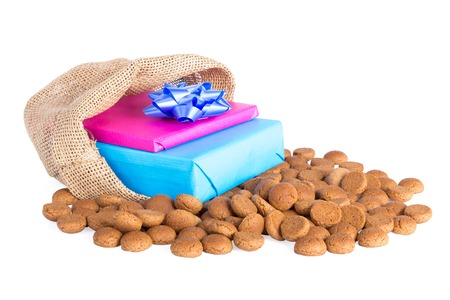 ginger nuts: Jute bag with ginger nuts and presents, a Dutch tradition at Sinterklaas event in december Stock Photo