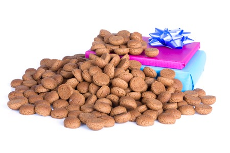 ginger nuts: Pile of ginger nuts and presents, a Dutch tradition at Sinterklaas event in december