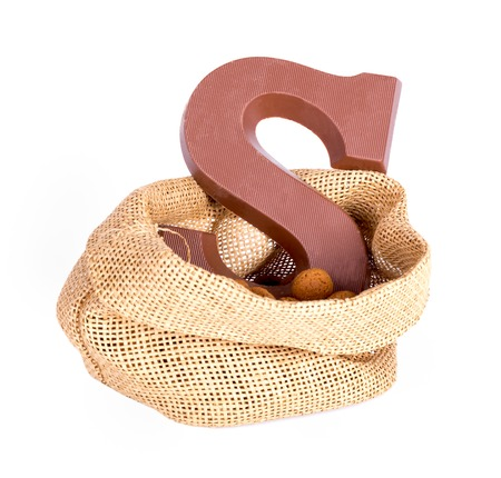 Jute bag with ginger nuts and chocolate; a Dutch tradition at Sinterklaas event in december photo