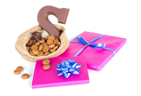 ginger nuts: Jute bag with chocolate, ginger nuts and presents; a Dutch tradition at Sinterklaas event in december