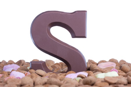 ginger nuts: Ginger nuts with chocolate letter S at Dutch children