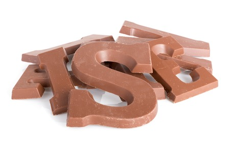 strooigoed: Pile of chocolate letters for Dutch event Sinterklaas in december Stock Photo