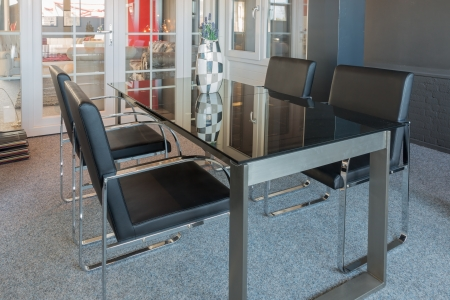 Showroom of modern furniture store with glass table and chairs photo