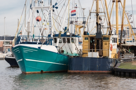 Dutch harbor of Urk with modern fishing cutters