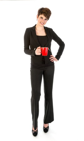 Slender businesswoman wit a cup of coffee photo