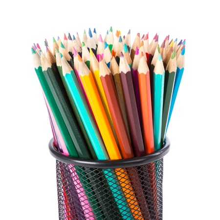 Colorful pencils in a black basket over a white background