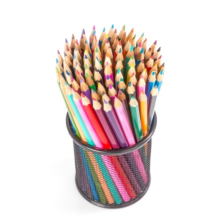 Colorful pencils in a black basket over a white background photo