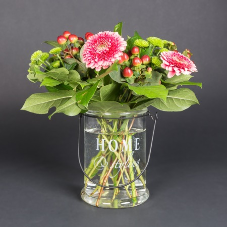 Bouquet of flowers in glass vase photo