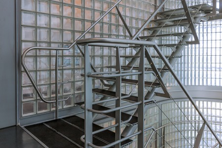 Steel stairway in a modern office building photo