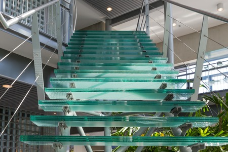 Glass stairway in a modern office building photo