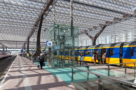 ROTTERDAM, THE NETHERLANDS - APRIL 16  Unknown travellers are entering and leaving a high speed train at the central station of Rotterdam on April 16, 2014 in the city of Rotterdam, the Netherlands