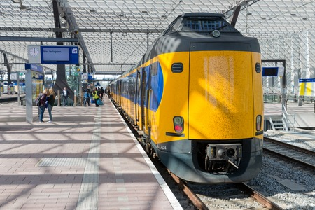 ROTTERDAM, THE NETHERLANDS - APRIL 16  Unknown travellers are entering and leaving the high speed train at the central station of Rotterdam on April 16, 2014 in the city of Rotterdam, the Netherlands