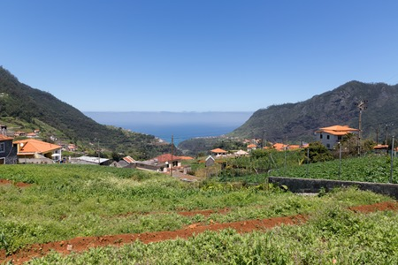 Landscape of Madeira with mountains, houses and agriculture photo