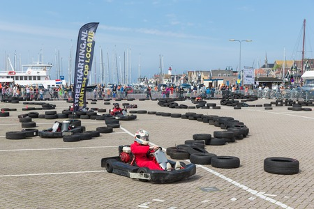 URK, THE NETHERLANDS - APR 26  Unknown people have fun with kart racing  at a national holiday at the harbor of Urk on April 26, 2014, the Netherlands