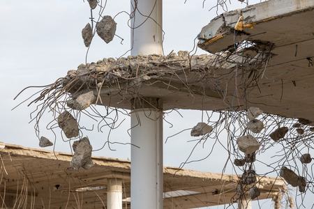 deconstruct: Demolition of a building with concrete floors and pillars