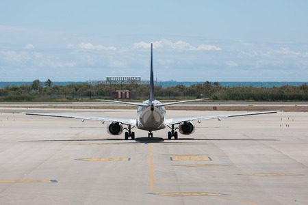 runways: A plane is ready for departure at the airport of Barcelona in Spain Editorial