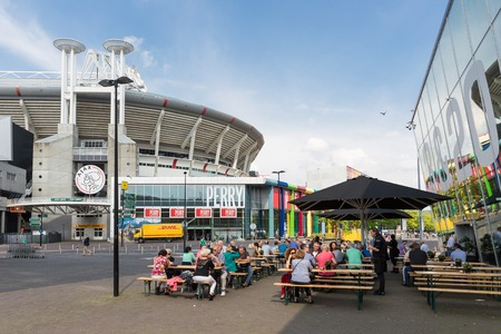 ajax: AMSTERDAM, THE NETHERLANDS - MAY 23  People sitting at a terrace near the soccer stadium from the Dutch football club Ajax on May 23, 2014 in Amsterdam, the Netherlands Editorial