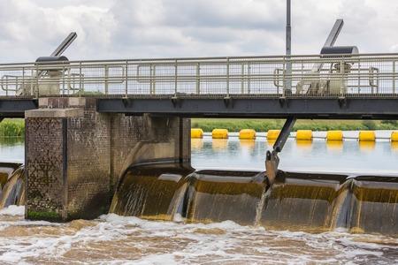 barrage: Concrete barrage in Dutch river Vecht Stock Photo