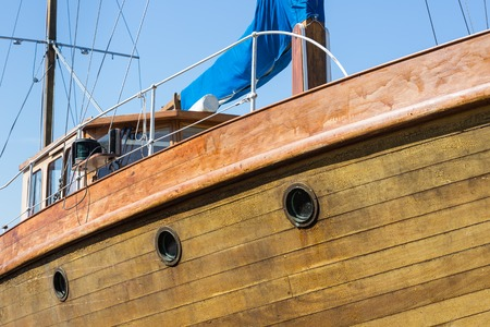 Front view of wooden yacht with portholes photo