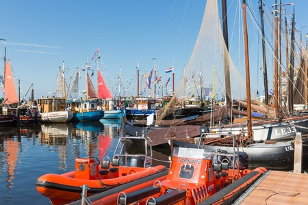 URK, THE NETHERLANDS - MAY 31  Fishing day with lifeboats and decorated traditional fishing ships on May 31, 2014 in the harbor of Urk, the Netherlands