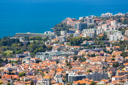 Aerial view of the westerly side of Funchal with many hotels; Madeira Island, Portugal