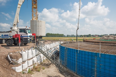 reinforcing: ESPEL, THE NETHERLANDS - JULY 29  Construction site of a foundation for a huge new Dutch wind turbine on July 29, 2014 at Espel, the Netherlands