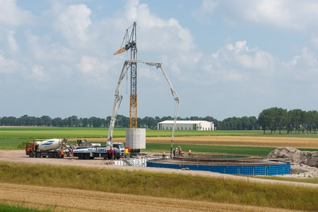 ESPEL, THE NETHERLANDS - JULY 29  Unknown workers preparing a concrete foundation of a Dutch wind turbine on July 29, 2014 at Espel, the Netherlands