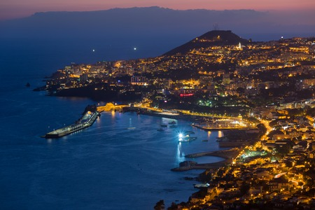 Aerial view of Funchal by night, Madeira Island, Portugal photo