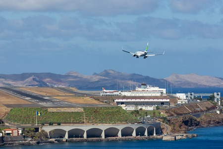 FUNCHAL, PORTUGAL - AUG 12: A Boeing 737 from Dutch airline Transavia is approaching Funchal Airport on Augustus 12, 2014 at Madeira, Portugal
