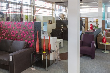 Furniture showroom with modern tables and chairs photo
