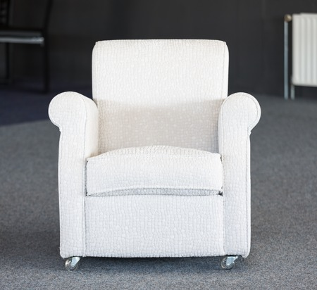 secondhand: White second-hand chair in a furniture warehouse