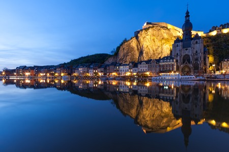 river stones: Cityscape of Dinant at night along the river Meuse, Belgium