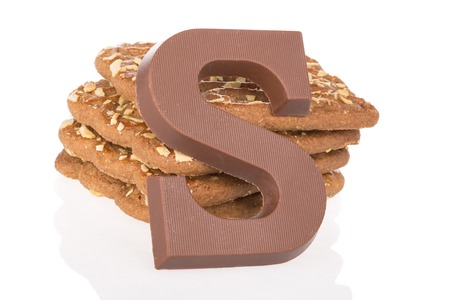 Chocolate letter and speculaas, Dutch sweets at 5 december Sinterklaas party photo