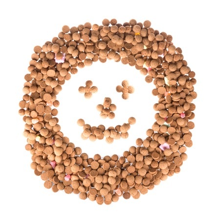 Happy face of ginger nuts isolated over white photo