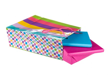 sinterklaas: Wrapped gifts in a colorful bag isolated on a white background