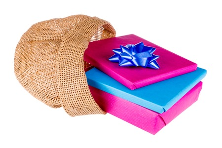 sac: Wrapped gifts in a jute bag isolated on a white background Stock Photo