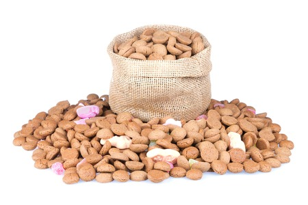 Jute bag filled with ginger nuts isolated over a white background photo