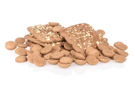 Heap of ginger nuts with speculaas over white photo