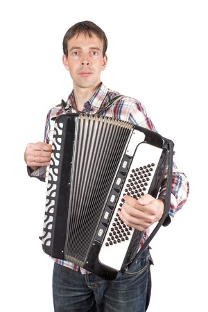 Man playing at an accordion isolated over white photo