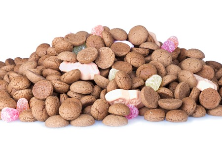 strooigoed: Heap of Dutch ginger nuts and sweets over white