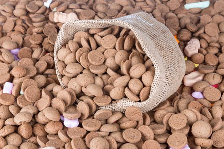 Background of ginger nuts and a filled jute bag photo