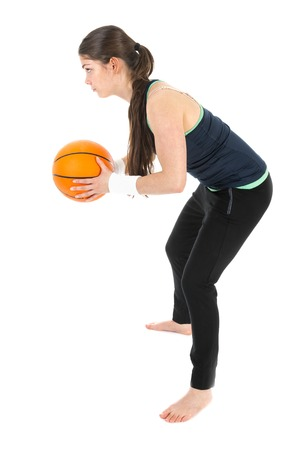 Pretty woman playing basketball, isolated on white background photo