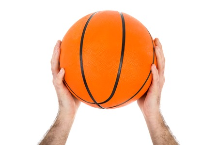 Two hands holding a basketball over a white background photo