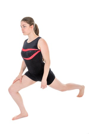 Young woman warming up for a gymnastics exercise. isolated at white background photo
