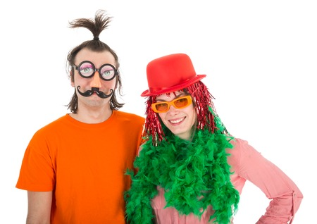 Man and Woman dressed in funny carnival costumes, isolated over white photo