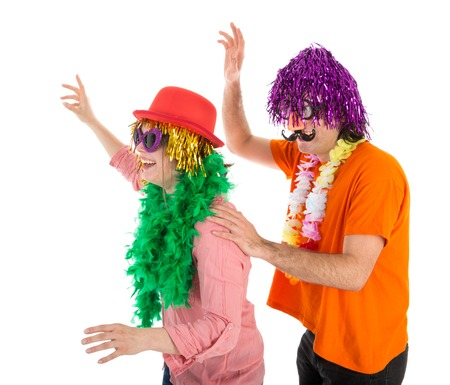 Man and Woman dressed in funny carnival costumes dancing a polonaise Stock Photo